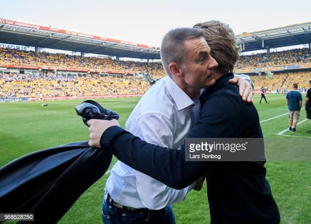 Jan Bech Andersen owner of Brondby IF and Rasmus Ankersen president of FC Midtjylland shake hands prior to the Danish Alka Superliga match between...