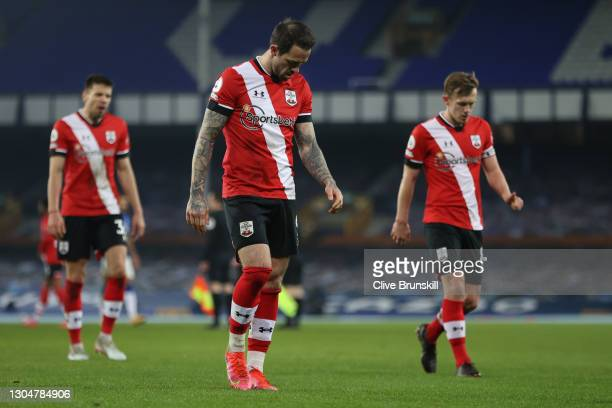 Jan Bednarek , Danny Ings and James Ward-Prowse of Southampton walk off dejected after the Premier League match between Everton and Southampton at...