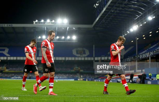 Jan Bednarek, Danny Ings and James Ward-Prowse of Southampton walk off the pitch during the Premier League match between Everton and Southampton at...