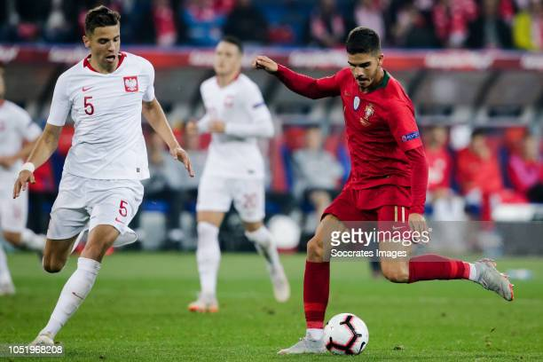 Jan Bednarek of Poland Andre Silva of Portugal during the UEFA Nations league match between Poland v Portugal at the Slaski Stadium on October 11...
