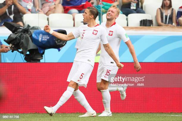 Jan Bednarek of Poland celebrates scoring a goal to make it 01 with Kamil Glik of Poland during the 2018 FIFA World Cup Russia group H match between...