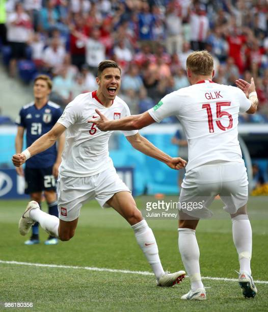 Jan Bednarek of Poland celebrates with teammate Kamil Glik after scoring his team's first goal during the 2018 FIFA World Cup Russia group H match...