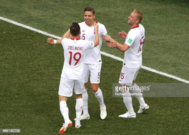 Jan Bednarek of Poland celebrates with teammates Piotr Zielinski and Kamil Glik after scoring his team's first goal during the 2018 FIFA World Cup...