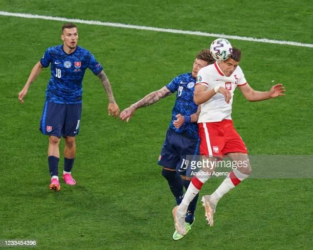 Jan Bednarek of Poland in action against Juraj Kucka of Slovakia during EURO 2020 Group E soccer match between Poland and Slovakia at Krestovsky...