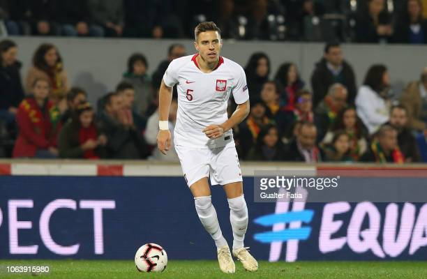 Jan Bednarek of Poland in action during the UEFA Nations League A Group 3 match between Portugal and Poland at Estadio D Afonso Henriques on November...