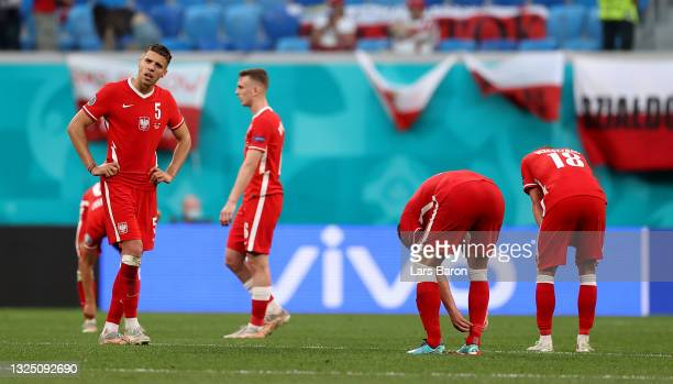 Jan Bednarek of Poland looks dejected with team mates following defeat in the UEFA Euro 2020 Championship Group E match between Sweden and Poland at...