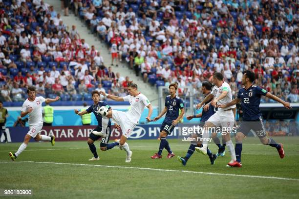 Jan Bednarek of Poland scores his team's first goal during the 2018 FIFA World Cup Russia group H match between Japan and Poland at Volgograd Arena...