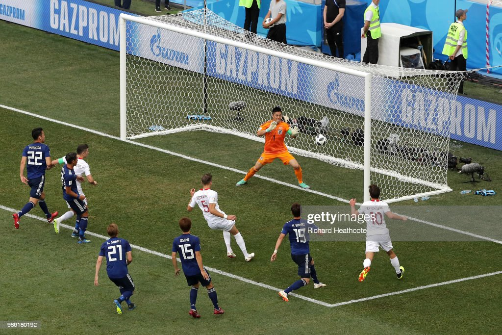 Jan Bednarek of Poland scores past Eiji Kawashima of Japan his team's first goal during the 2018 FIFA World Cup Russia group H match between Japan and Poland at Volgograd Arena on June 28, 2018 in Volgograd, Russia.