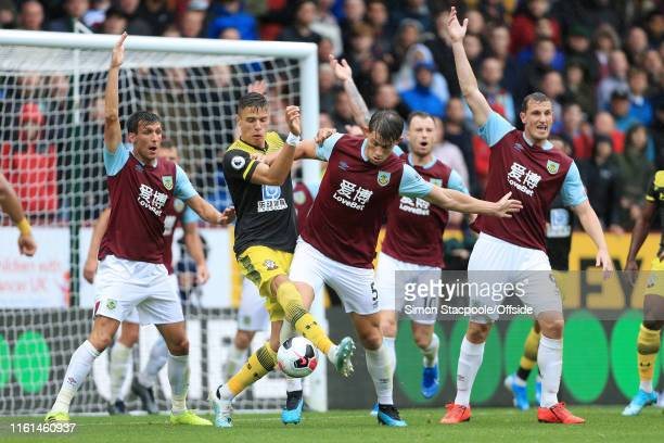 Jan Bednarek of Southampton battles with James Tarkowski of Burnley during the Premier League match between Burnley and Southampton at Turf Moor on...