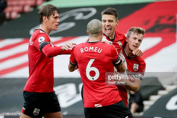 Jan Bednarek of Southampton beats David De Gea of Manchester United with a header and scores a goal to make it 1-0 and celebrates with team-mates...