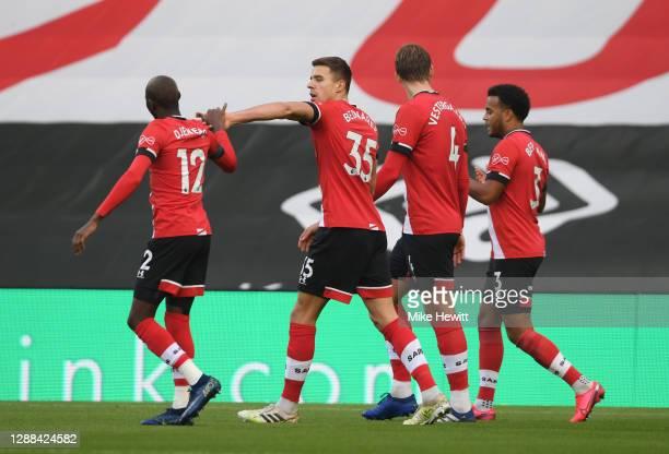 Jan Bednarek of Southampton celebrates with Moussa Djenepo and Jannik Vestergaard and Ryan Bertrand of Southampton after scoring their sides first...