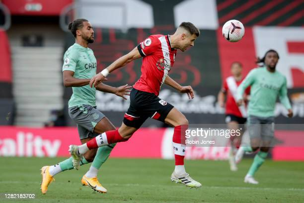 Jan Bednarek of Southampton clears the ball from from Dominic CalvertLewin of Everton during the Premier League match between Southampton and Everton...