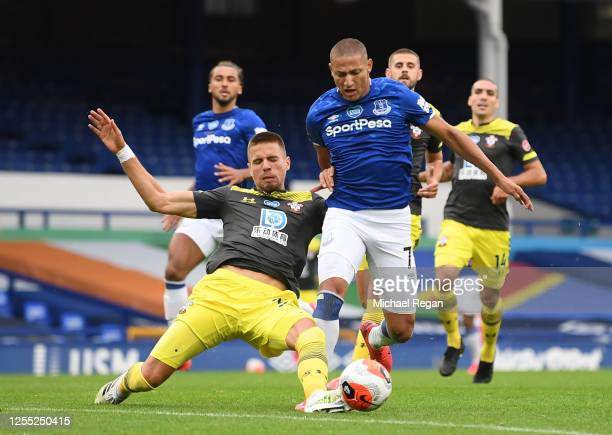 Jan Bednarek of Southampton fouls Richarlison of Everton during the Premier League match between Everton FC and Southampton FC at Goodison Park on...