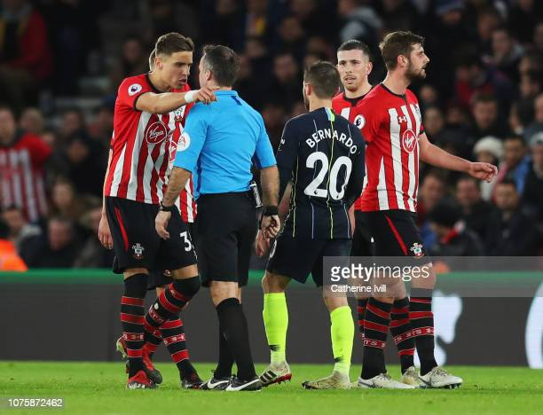 Jan Bednarek of Southampton in discussion with referee Paul Tierney as PierreEmile Hojbjerg of Southampton is sent off during the Premier League...