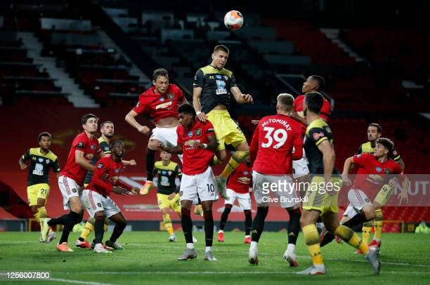 Jan Bednarek of Southampton shoots a header during the Premier League match between Manchester United and Southampton FC at Old Trafford on July 13...
