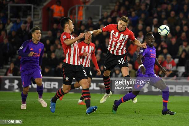 Jan Bednarek of Southampton wins a header during the Premier League match between Southampton FC and Liverpool FC at St Mary's Stadium on April 05...