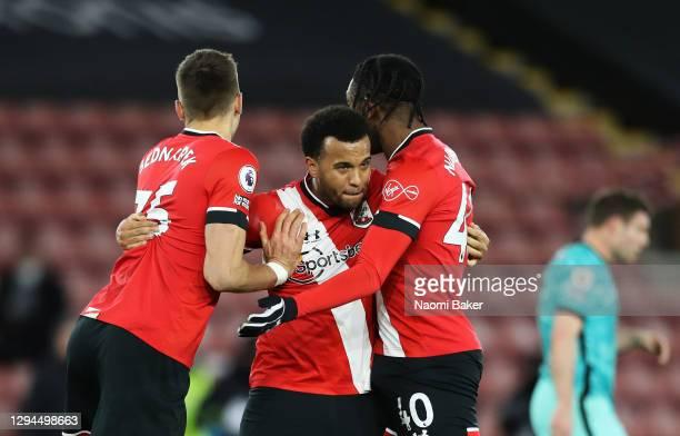 Jan Bednarek, Ryan Bertrand and Dan N'Lundulu of Southampton celebrate victory after the Premier League match between Southampton and Liverpool at St...