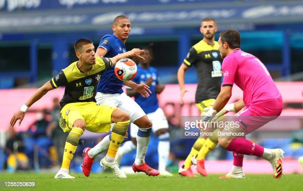 Jan Benarek and Alex McCarthy of Southampton FC and Richarlison of Everton in action during the Premier League match between Everton FC and...