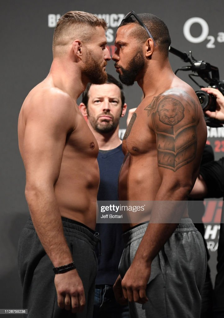 jan-blachowicz-of-poland-and-thiago-santos-of-brazil-face-off-during-picture-id1126755238