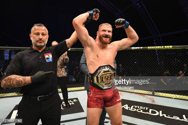 Jan Blachowicz of Poland celebrates after defeating Dominick Reyes in their light heavyweight championship bout during UFC 253 inside Flash Forum on...