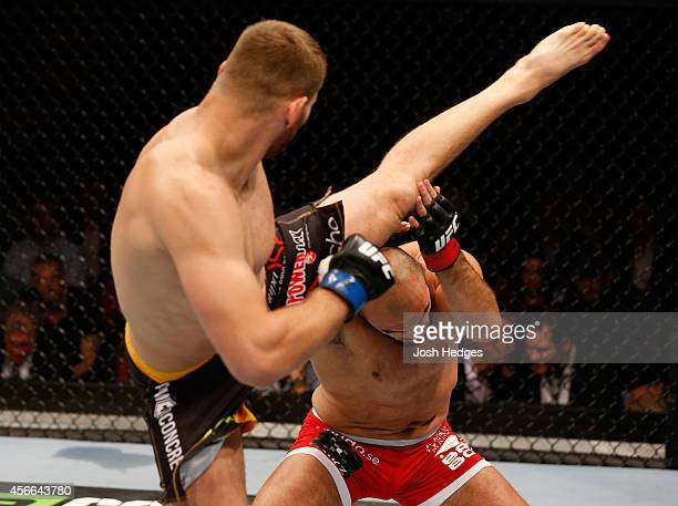 Jan Blachowicz of Poland kicks Ilir Latifi of Sweden in their light heavyweight bout at the Ericsson Globe Arena on October 4 2014 in Stockholm Sweden
