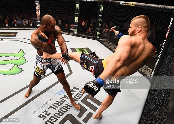 Jan Blachowicz of Poland kicks Jimi Manuwa of England in their light heavyweight fight during the UFC Fight Night event at the Tauron Arena on April...