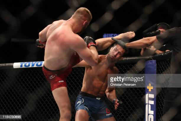 Jan Blachowicz of Poland kicks Luke Rockhold in their light heavyweight fight during the UFC 239 event at TMobile Arena on July 6 2019 in Las Vegas...