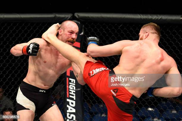 Jan Blachowicz of Poland lands a kick on Patrick Cummins in their light heavyweight bout during the UFC 210 event at KeyBank Center on April 8 2017...