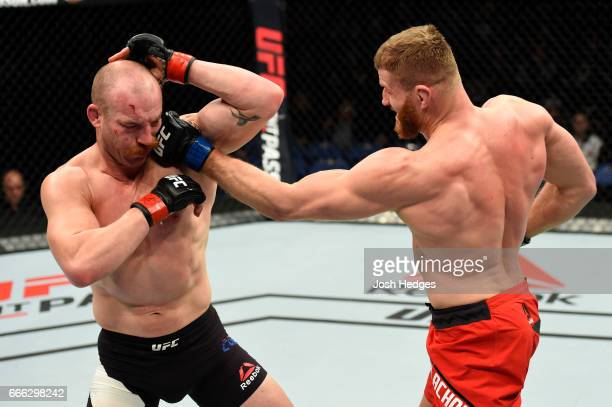Jan Blachowicz of Poland lands a punch on Patrick Cummins in their light heavyweight bout during the UFC 210 event at KeyBank Center on April 8 2017...