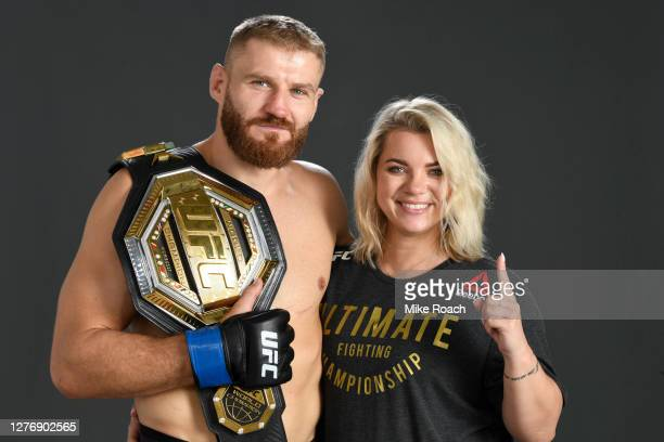 Jan Blachowicz of Poland poses for a post fight portrait with his wife Dorota Jurkowska backstage during UFC 253 inside Flash Forum on UFC Fight...