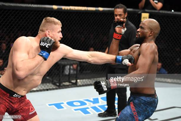 Jan Blachowicz of Poland punches Corey Anderson in their light heavyweight bout during the UFC Fight Night event at Santa Ana Star Center on February...