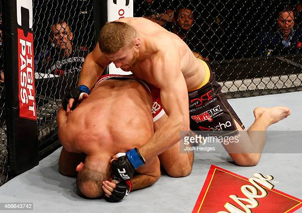 Jan Blachowicz of Poland punches Ilir Latifi of Sweden in their light heavyweight bout at the Ericsson Globe Arena on October 4 2014 in Stockholm...