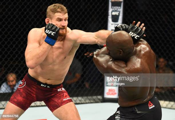 Jan Blachowicz of Poland punches Jared Cannonier in their light heavyweight bout during the UFC Fight Night event at Bell MTS Place on December 16...