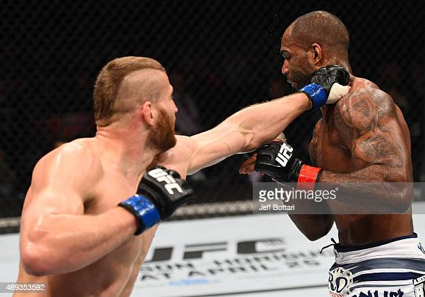 Jan Blachowicz of Poland punches Jimi Manuwa of England in their light heavyweight fight during the UFC Fight Night event at the Tauron Arena on...