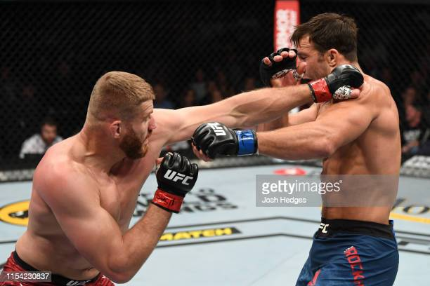 Jan Blachowicz of Poland punches Luke Rockhold in their light heavyweight fight during the UFC 239 event at TMobile Arena on July 6 2019 in Las Vegas...
