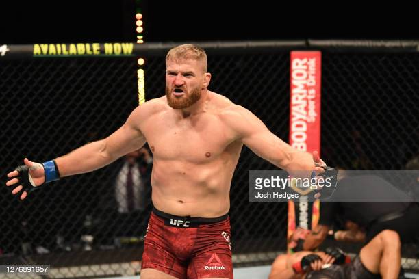 Jan Blachowicz of Poland reacts after defeating Dominick Reyes in their light heavyweight championship bout during UFC 253 inside Flash Forum on UFC...