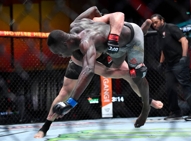 Jan Blachowicz of Poland takes down Israel Adesanya of Nigeria in their UFC light heavyweight championship fight during the UFC 259 event at UFC APEX...