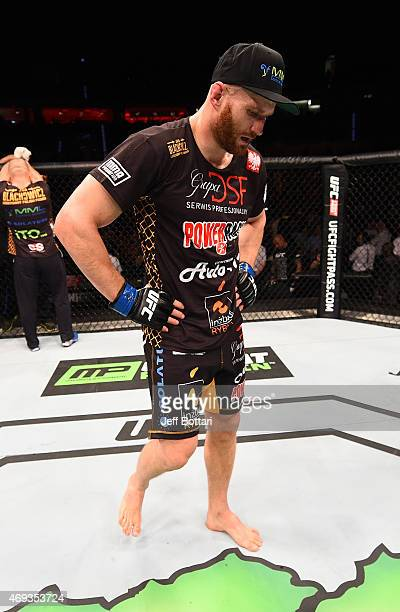 Jan Blachowicz of Poland walks away dejected after his decision loss to Jimi Manuwa of England in their light heavyweight fight during the UFC Fight...