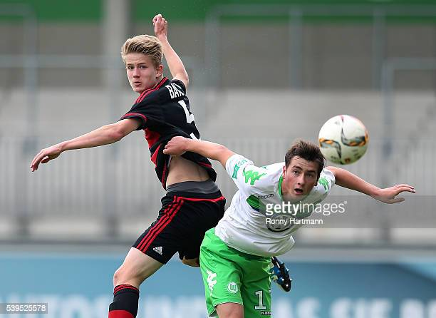 Jan Boller of Leverkusen heads for the ball with with Yari Otto of Wolfsburg during the U17 German Championship Semi Final Second Leg between VfL...