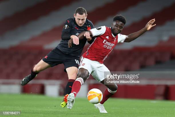 Jan Boril of Slavia battles with Bukayo Saka of Arsenal during the UEFA Europa League Quarter Final First Leg match between Arsenal FC and Slavia...