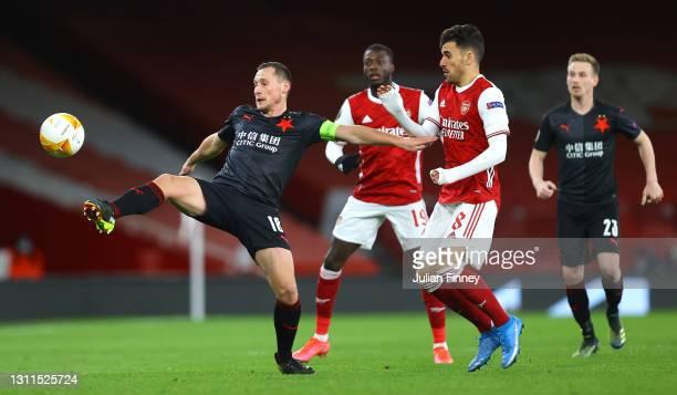 Jan Boril of Slavia Praha battles for possession with Dani Ceballos of Arsenal during the UEFA Europa League Quarter Final First Leg match between...