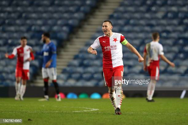 Jan Boril of Slavia Praha celebrates his side's victory after the UEFA Europa League Round of 16 Second Leg match between Rangers and Slavia Praha at...