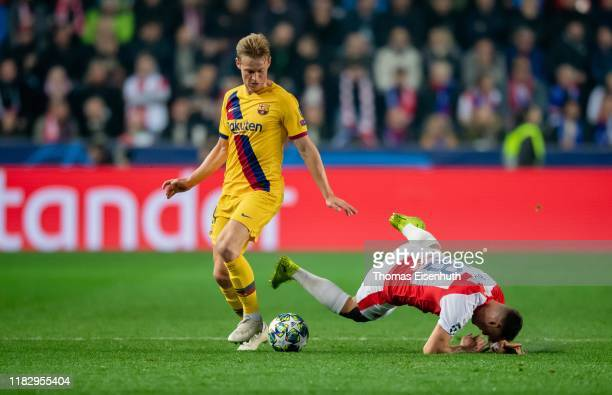 Jan Boril of Slavia Praha is challenged by Frenkie de Jong of Barcelona during the UEFA Champions League group F match between Slavia Praha and FC...