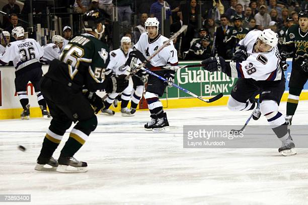 Jan Bulis of the Vancouver Canucks shoots the puck by Jussi Jokinen of the Dallas Stars during the first overtime period of game three of the 2007...