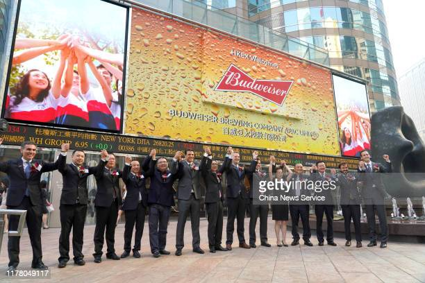 Jan Craps , chief executive officer of Budweiser Brewing Company APAC Ltd., and Frank Wang , executive director, general counsel and joint company...