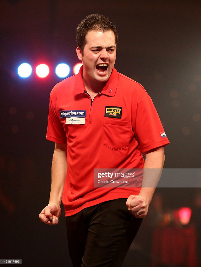 Jan Dekker of Holland celebrates winning a set during his semi-final match against Alan Norris of England during the BDO Lakeside World Professional Darts Championships at Lakeside Complex on January 11, 2014 in Frimley, England.