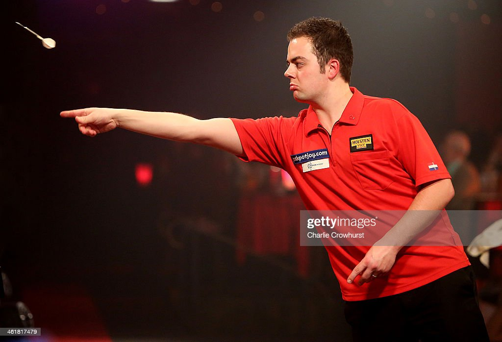 Jan Dekker of Holland in action during his semi-final match against Alan Norris of England during the BDO Lakeside World Professional Darts Championships at Lakeside Complex on January 11, 2014 in Frimley, England.
