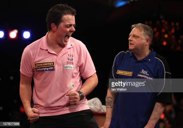 Jan Dekker of the Netherlands celebrates after winning against Garry Thompson of England during the Quarter Final match on January 7 2011 in Frimley...