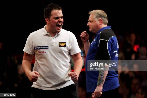 Jan Dekker of the Netherlands celebrates during his second round match against Garry Thompson of England on day five the BDO Lakeside World...