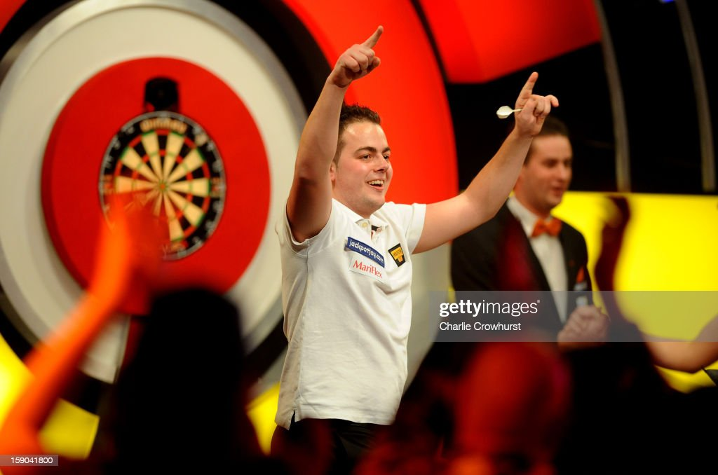 Jan Dekker of The Netherlands celebrates winning his first round match against Jeffrey De Graaf of The Netherlands on day two of the BDO Lakeside World Professional Darts Championships at Lakeside Country Club on January 06, 2013 in London, England.